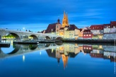 Germany, Bavaria, Upper Palatinate, Regensburg - The Stone Bridge, St. Peter's Church and the Old Town of Regensburg reflecting on the Danube river